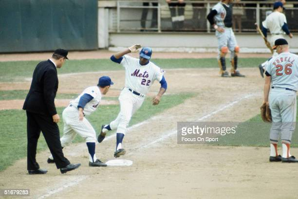 Donn Clendenon of the New York Mets touches first base as he rounds the bases on a home run against the Baltimore Orioles at Shea Stadium on October...