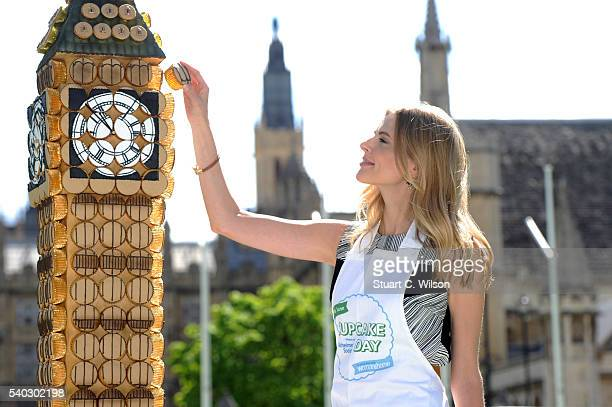 Donna Air and the Alzheimer's Society create a giant Big Ben in cupcakes to mark Cupcake Day at Parliament Square on June 15, 2016 in London, England.
