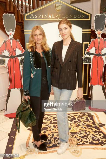 Donna Air wearing the Large Florence in Evergreen Croc and Freya Air Aspinall wearing the Trinket Box in Bordeaux Croc attend the Aspinal of London...
