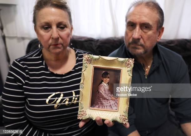 Donna and Gordon Packer hold a photo of their 10-year-old daughter, Lacey Packer in Raymond, NH on Nov. 24, 2019. Lacey was killed by a drunk driver...