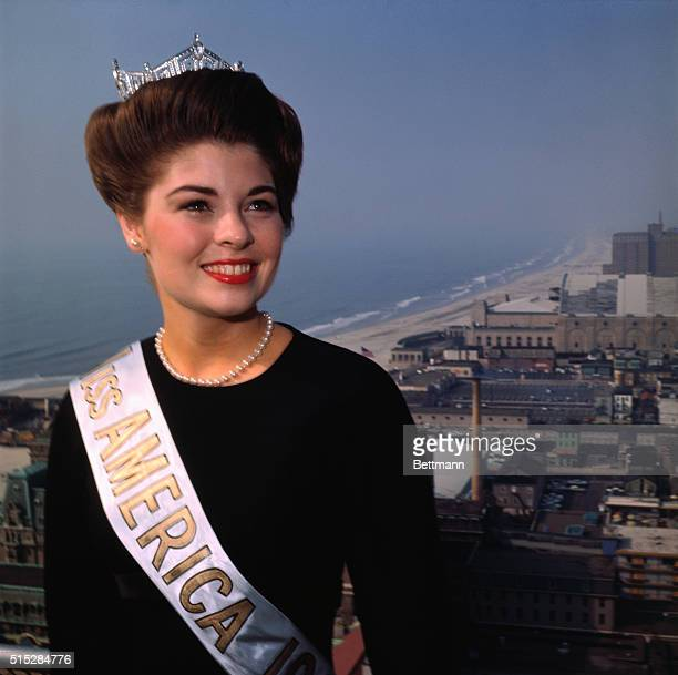 Donna Axum of Arkansas selected Miss America for 1964 stands atop an Atlantic City hotel over looking the ocean