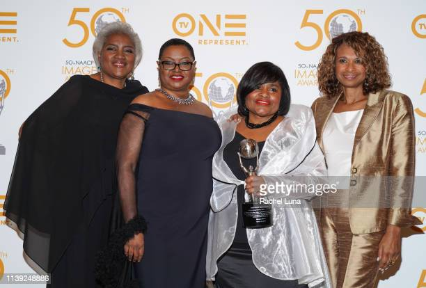 Donna Brasile Leah Daughtry Minyon Moore and Yolanda Caraway pose in the press room at the 50th NAACP Image Awards NonTelevised Dinner at Beverly...