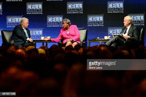 Donna Brazile response to Haley Barbour while Chris Matthews listens during the Colorado Remembers 9/11 Commemoration and Event on September 10 2015...