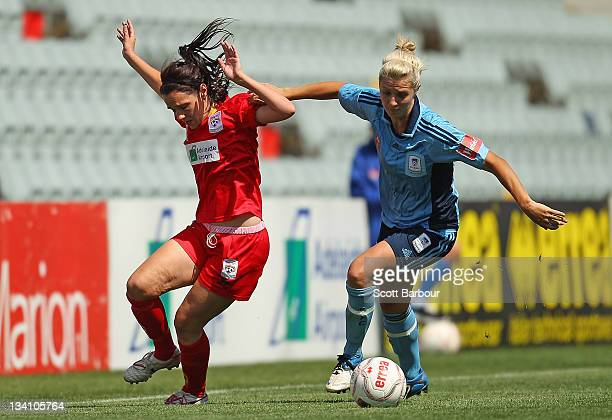 Donna Cockayne of United competes with Danielle Brogan of Sydney FC for the ball during the round six WLeague match between Adelaide United and...