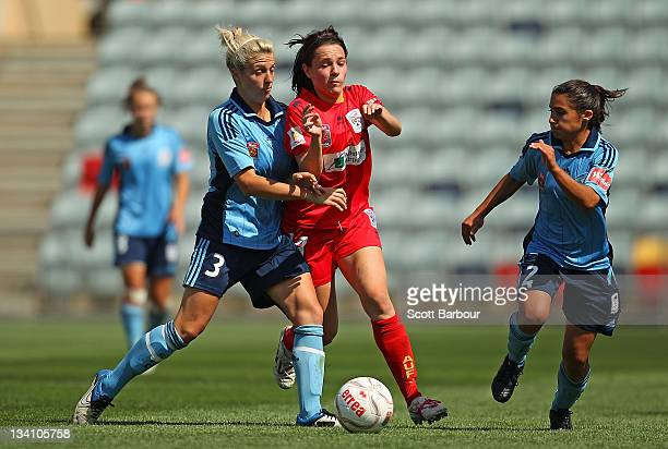 Donna Cockayne of United competes with Terasa Polias and Danielle Brogan of Sydney FC for the ball during the round six WLeague match between...