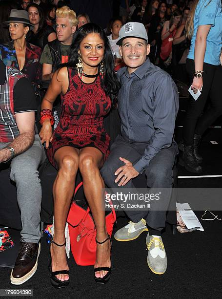 Donna D'Cruz and Phillip Bloch attend the Desigual show during Spring 2014 MercedesBenz Fashion Week at The Theatre at Lincoln Center on September 5...