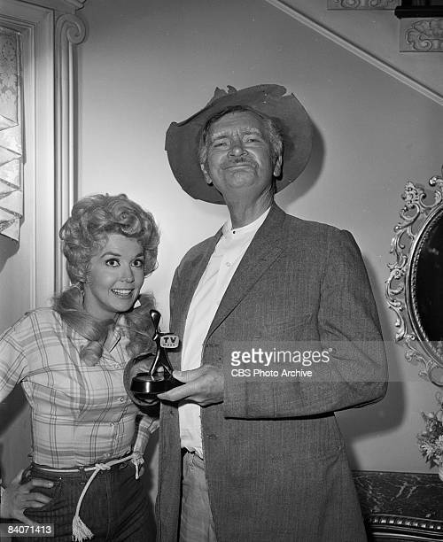 Donna Douglas as Elly May Clampett left and Buddy Ebsen as Jed Clampett of the television show 'The Beverly Hillbillies' holding the Australian...