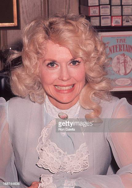 Donna Douglas attends The Sting Trophy Poker Championship on May 25 1977 at Chasen's Restaurant in Beverly Hills California