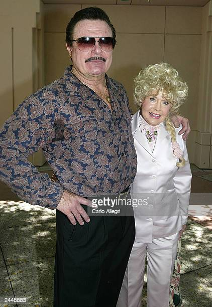 Donna Douglas Ellie May from the show Beverly Hillbillies and Max Baer Jr Jethro from the show Beverly Hillbillies hug outside the Academy of...