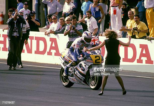 Donna fiancee of Wayne Gardner of Australia for the Rothmans Honda Team runs onto the track to congratulate him after winning the 1990 Australian...