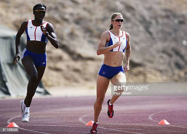 Donna Fraser and Catherine Murphy of Great Britain warm up at the Athletics Stadium in Paphos near the Team GB Holding Camp on August 11 2004 in...