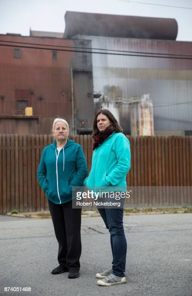 Donna Frederick left and Rachel Filippini right stand opposite the Allegheny Technologies Inc steel mill October 26 2017 in Natrona Heights...