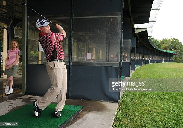 Donna Hanover looks on as Andrew Giuliani son of former New York City mayor Rudy Giuliani hits some balls at Randalls Island Golf Center Giuliani is...