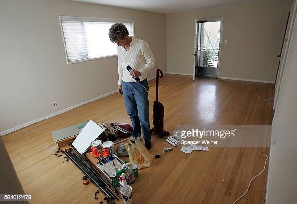 Donna Heinel doing work on her newly listed for sale Long Beach condo Repairs and minor improvements can help you sell your house say experts...