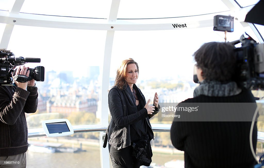 Donna Karan, chief designer of Donna Karan International Inc., center, reacts during a Bloomberg Television interview on the EDF Energy London Eye in London, U.K., on Wednesday, Nov. 14, 2012. Retail sales in the U.S. fell in October for the first time in four months, influenced by the effects of superstorm Sandy, which hurt receipts for some and helped for others. Photographer: Chris Ratcliffe/Bloomberg via Getty Images