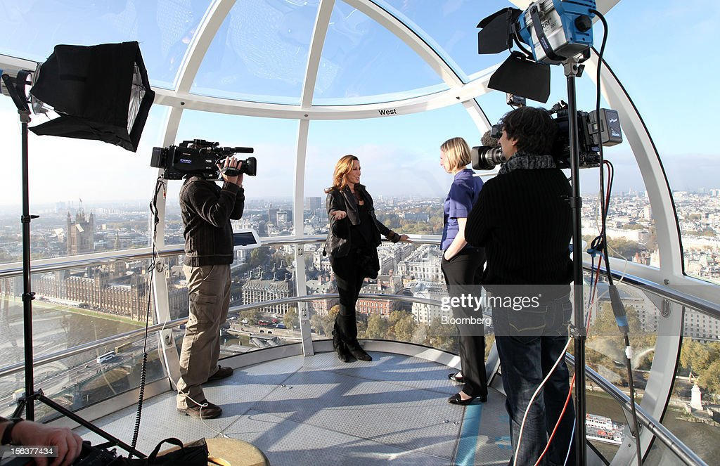 Donna Karan, chief designer of Donna Karan International Inc., center, speaks during a Bloomberg Television interview on the EDF Energy London Eye in London, U.K., on Wednesday, Nov. 14, 2012. Retail sales in the U.S. fell in October for the first time in four months, influenced by the effects of superstorm Sandy, which hurt receipts for some and helped for others. Photographer: Chris Ratcliffe/Bloomberg via Getty Images