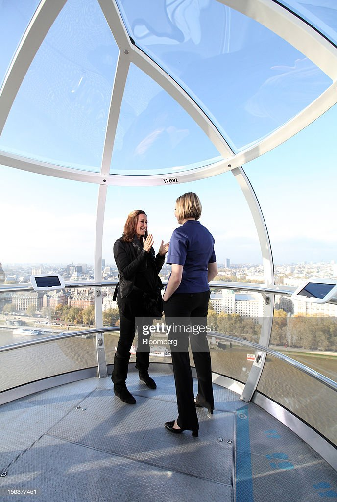 Donna Karan, chief designer of Donna Karan International Inc., left, speaks during a Bloomberg Television interview on the EDF Energy London Eye in London, U.K., on Wednesday, Nov. 14, 2012. Retail sales in the U.S. fell in October for the first time in four months, influenced by the effects of superstorm Sandy, which hurt receipts for some and helped for others. Photographer: Chris Ratcliffe/Bloomberg via Getty Images