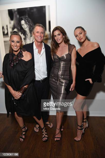 Donna Karan Russell James Cindy Crawford and Candice Swanepoel attend the 'ANGELS' by Russell James book launch and exhibit hosted by Cindy Crawford...