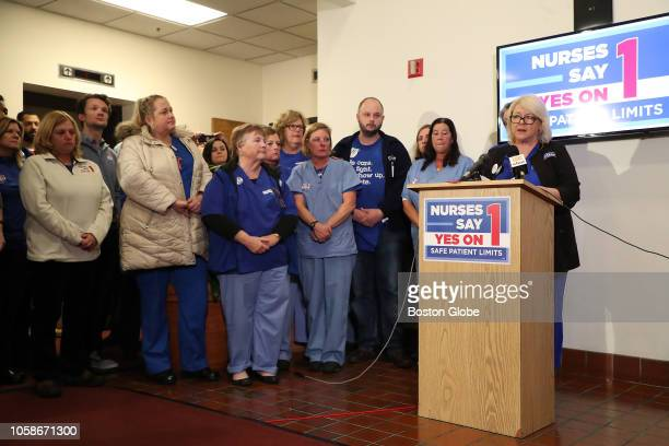 Donna KellyWilliams President of the Massachusetts Nurses Association is flanked by nurses and supporters at the organization's headquarters in...