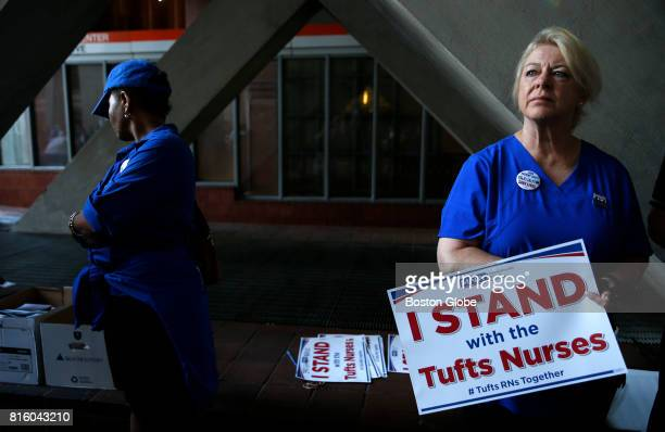 Donna KellyWilliams RN stood with a sign as she waited for other Tufts Medical Center nurses to assemble and head back into work in Boston on July 17...