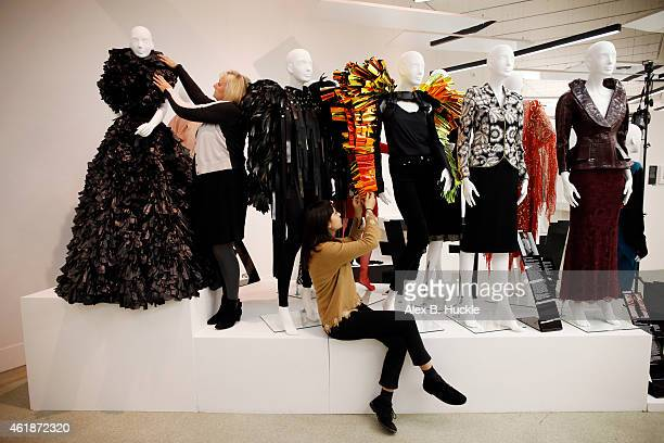 Donna Loveday and Angela Tye make finishing touches to the 'Women Fashion Power' exhibition at the Design Museum where an Iconic Lady Gaga dress...
