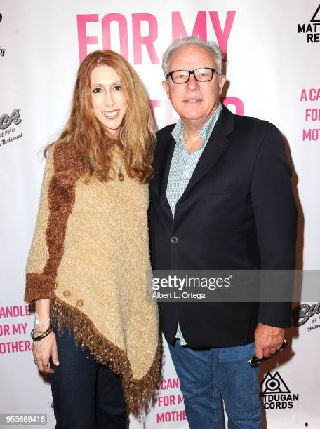 Donna Loyd and Guy Langvardt arrive for a luncheon in honor of Mother's Day for the release of Pamela L Newton's 'A Candle For My Mother' held at Los...