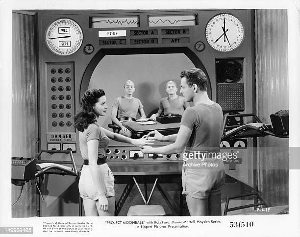 Donna Martell gets ring from Ross Ford in a scene from the film 'Project Moon Base' 1953