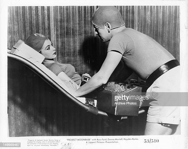 Donna Martell is latched into chair in a scene from the film 'Project Moon Base' 1953