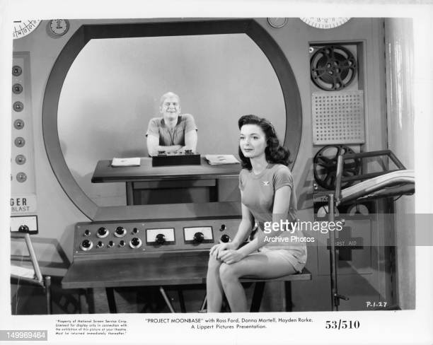 Donna Martell sitting on control room in a scene from the film 'Project Moon Base' 1953