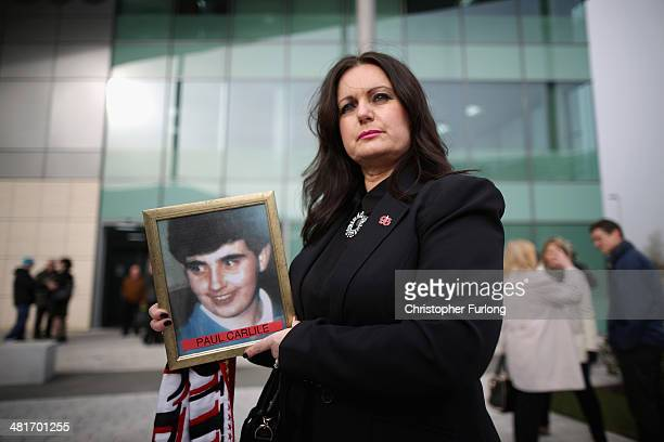 Donna Miller, the sister of victim Paul Carlile, arrives on the opening day for the fresh coroners inquest into the deaths of 96 Liverpool football...