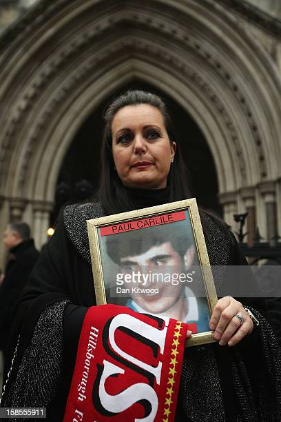 Donna Miller the sister of victim Paul Carlile joins the families of the 96 football fans who lost their lives in the Hillsborough disaster outside...