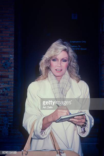 Donna Mills signing autographs She is wearing a white coat circa 1970 New York