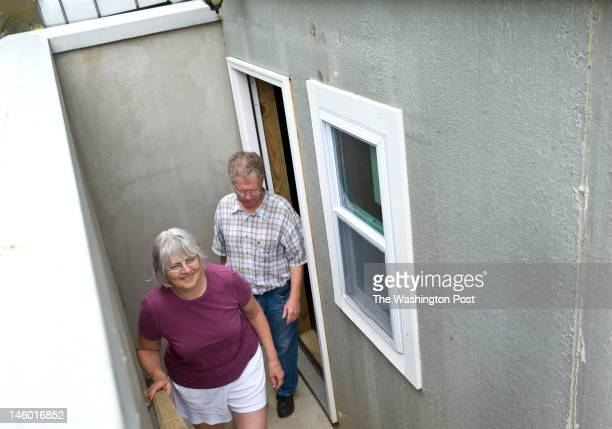 Donna Olsen and Chuck Dulaney leave their basement Monday June 2012 in Kensington MD They create the separate entrance knowing that they would finish...