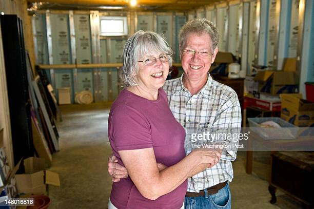 Donna Olsen and Chuck Dulaney pose in their roughed out basement Monday June 2012 in Kensington MD They planned from the beginning to turn their...