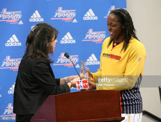 Donna Orender President of the WNBA presents Ebony Hoffman of the Indiana Fever with the 2008 WNBA Most Improved Player prior to the Fever taking on...
