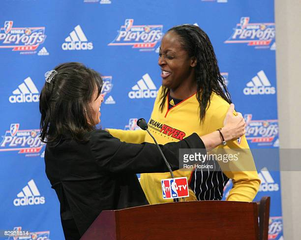 Donna Orender President of the WNBA presents Ebony Hoffman of the Indiana Fever with the 2008 WNBA Most Improved Player Award prior to the Fever...