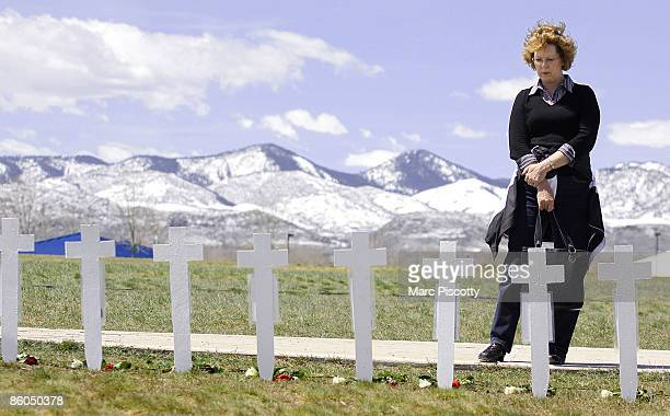Donna Polodna of Highlands Ranch Colorado pauses to take a look at some 13 crosses representing the Columbine High School shooting victims on the...