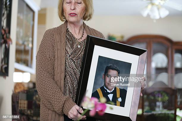 WINDSOR Nova Scotia APRIL 7 Donna Rice holds a photo of her son Glen at their home in Windsor Nova Scotia Glen Race's parents hope they they can get...