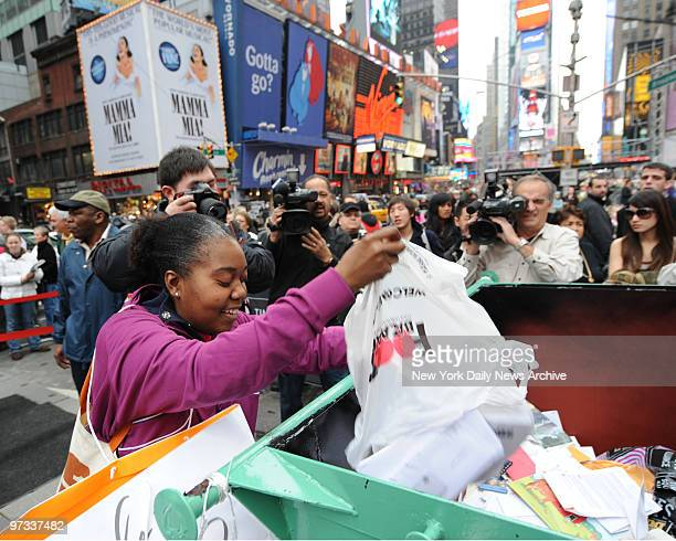 Donna Roberts of Corona Queens throws away 401K statements old bank records and other ghosts of bad times in 2008 in Times Square Sunday afternoon...