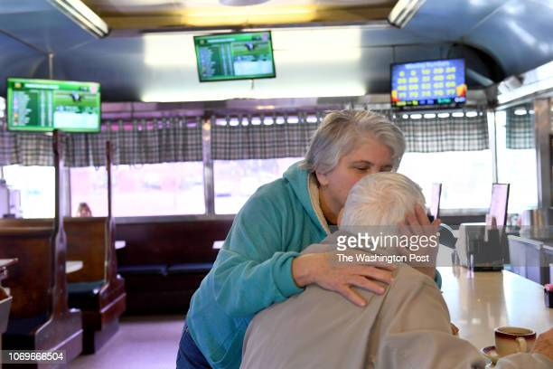Donna Rock who was off work but still helping out gives a kiss to George Jones a regular who she hasn't seen in awhile at the Tastee Diner December...