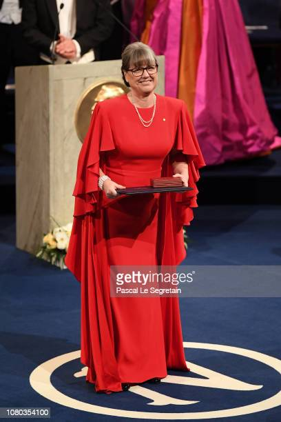 Donna Strickland laureate of the Nobel Prize in Physics acknowledges applause after she received her Nobel Prize from King Carl XVI Gustaf of Sweden...