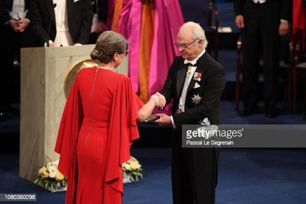 Donna Strickland laureate of the Nobel Prize in Physics receives her Nobel Prize from King Carl XVI Gustaf of Sweden during the Nobel Prize Awards...