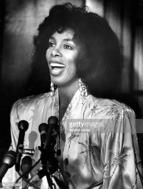 Donna Summer receives an award during a concert paying tribute to Dr Martin Luther King Jr on his birthday Jan 15 at the Park Plaza Hotel in Boston