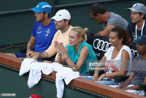 Donna Vekic of Croatia and Iva Majoli watch Stanislas Wawrinka of Switzerland play against Philipp Kohlschreiber of Germany in their third round...
