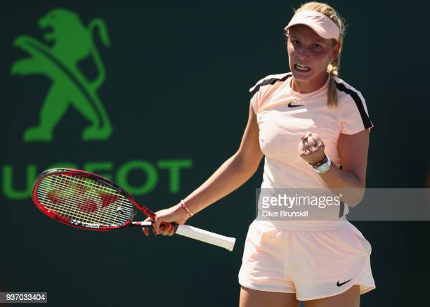 Donna Vekic of Croatia celebrates a point against Elena Vesnina of Russia in their second round match during the Miami Open Presented by Itau at...