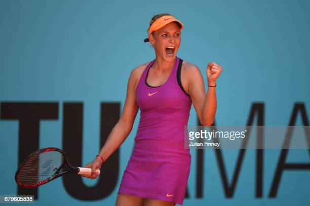 Donna Vekic of Croatia celebrates winning the first set in her match against Shelby Rogers of USA during day one of the Mutua Madrid Open tennis at...