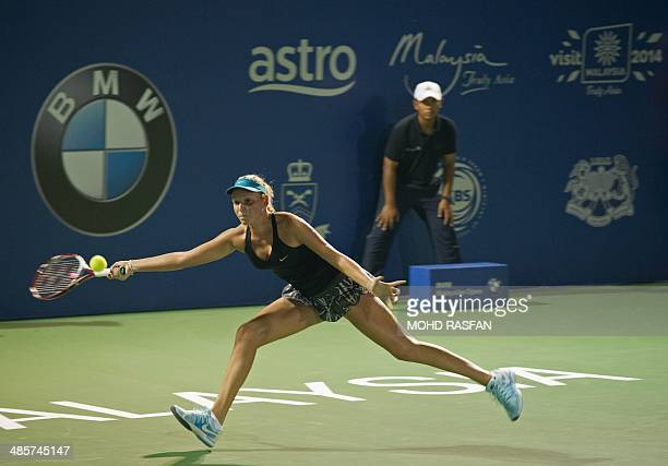 Donna Vekic of Croatia hits a return against Dominika Cibulkova of Slovakia during the final match of the BMW Malaysian Open tennis tournament in...