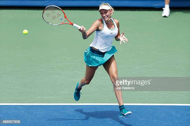 Donna Vekic of Croatia hits a return to Varvara Lepchenko of the United States during their qualifying match on Day 1 of the Western Southern Open on...