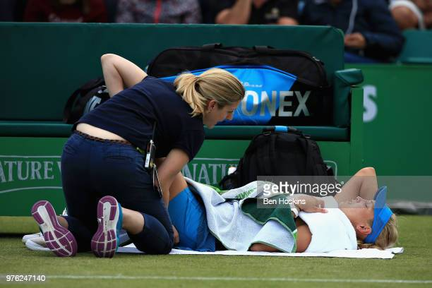 Donna Vekic of Croatia is tended to by a physio in the Womens Singles Semi Final during Day Eight of the Nature Valley Open at Nottingham Tennis...