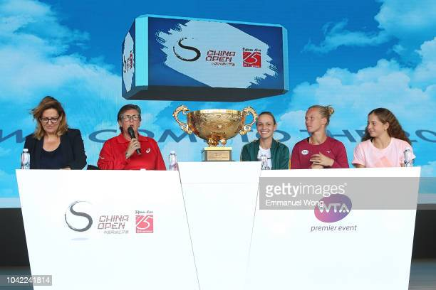 Donna Vekic of Croatia Kiki Bertens of the Netherlands Jelena Ostapenko of Latvia attend a Draw ceremony at the Mercedes Benz booth during the...